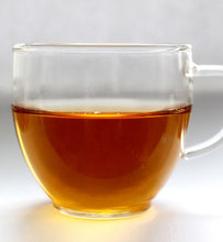 Organic Earl Grey Tea in clear glass teacup