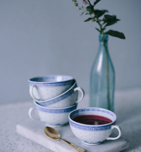teacup filled with raspberry green tea