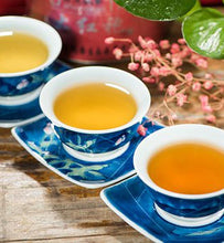different types of brewed green teas in porcelain tea cups