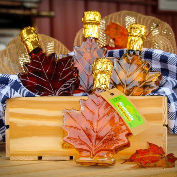 Image includes four (3.4oz) leaves of Pure Grade A Maple Syrup in Golden Delicate, Amber Rich, Dark Robust, and Very Dark Strong.
