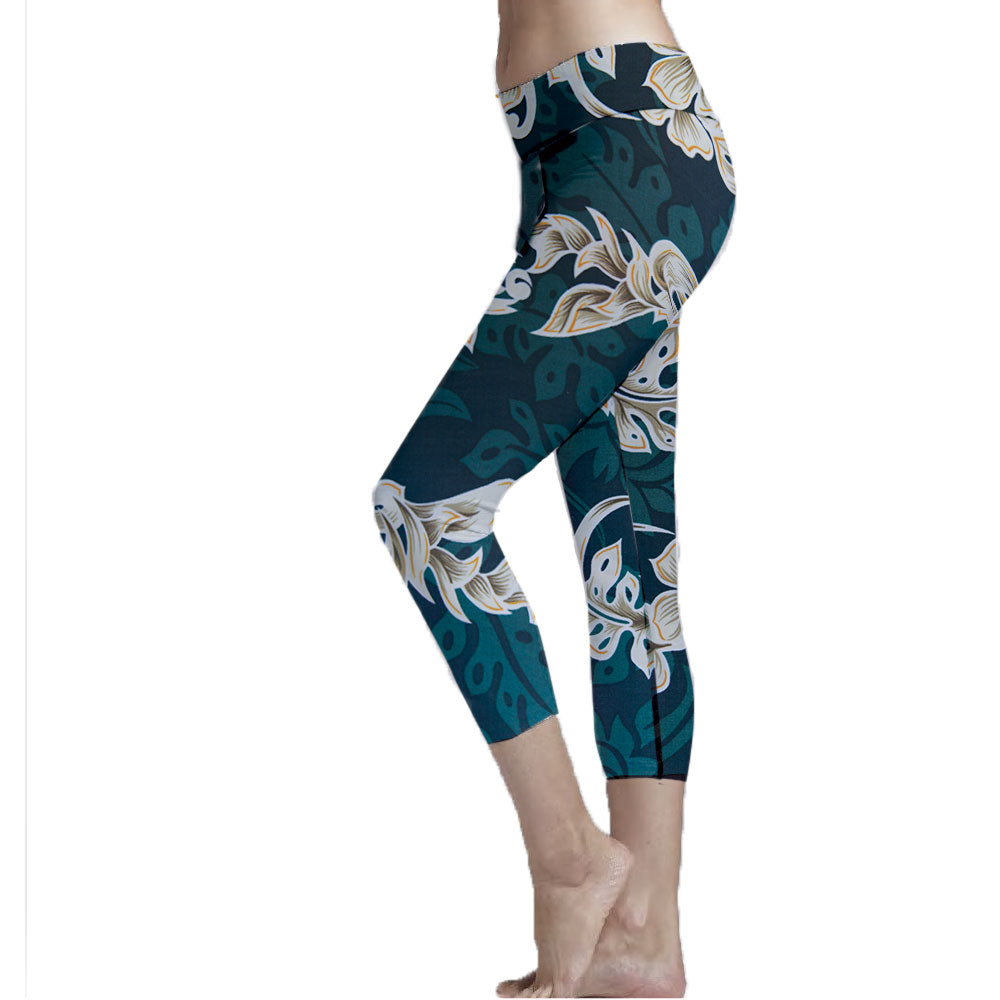 Emerald Lei Hawaiian Print Cropped Leggings made with recycle plastic bottle polyester fabric.  Super Soft Ultra Light Eco-Fabric Mid Shin Length Cropped Leggings Sustainable Activewear Ultra flattering wide waistband Durable flatlock stitching  Engineered 6 panel construction