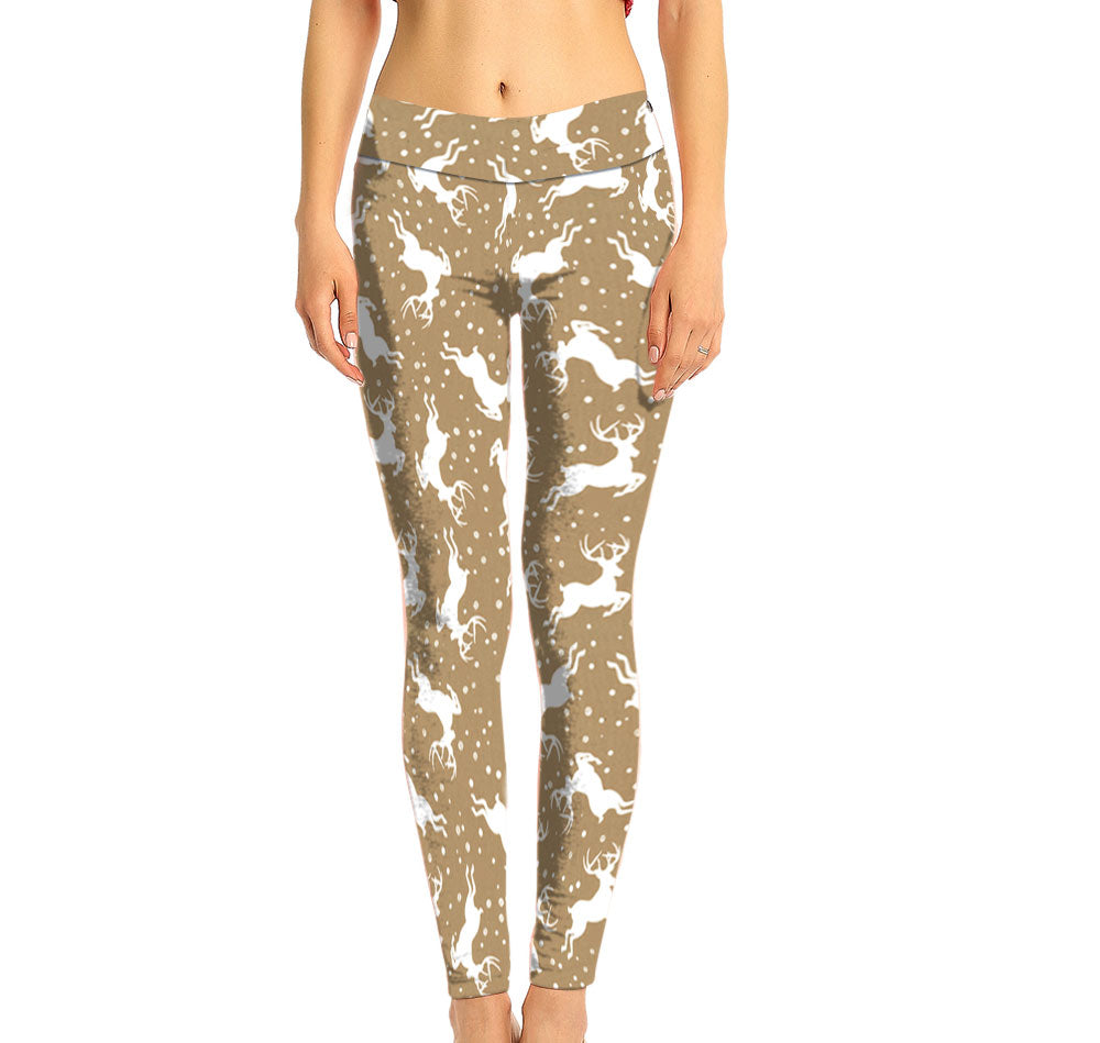 Tan with White Reindeer Pattern on a Mid Rise Legging. Made with Recycled Plastic Fabric.
