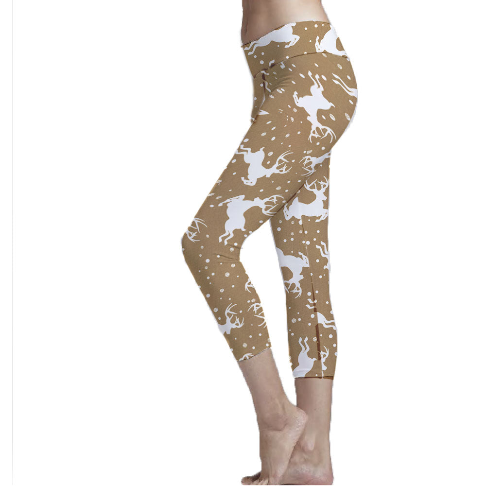 Tan and Deer Christmas Reindeer Pattern Cropped Legging made with sustainable recycled fabrics.