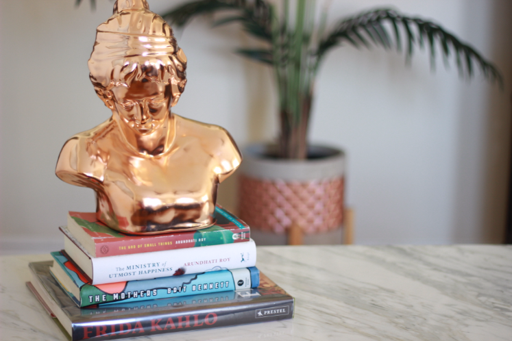 rose gold sculpture and book end