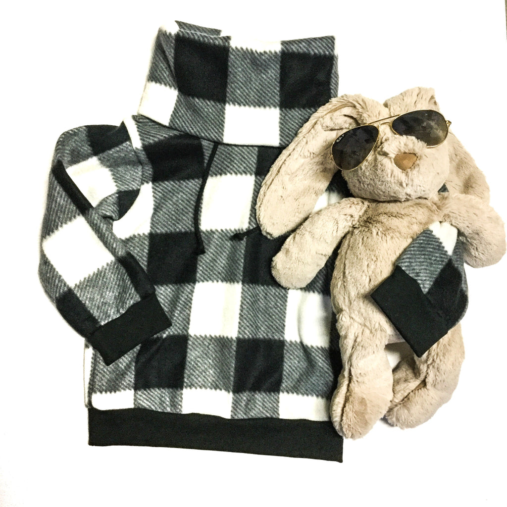 monochrome turtleneck Black and white plaid cowl sweater with a plush bunny in sunglasses