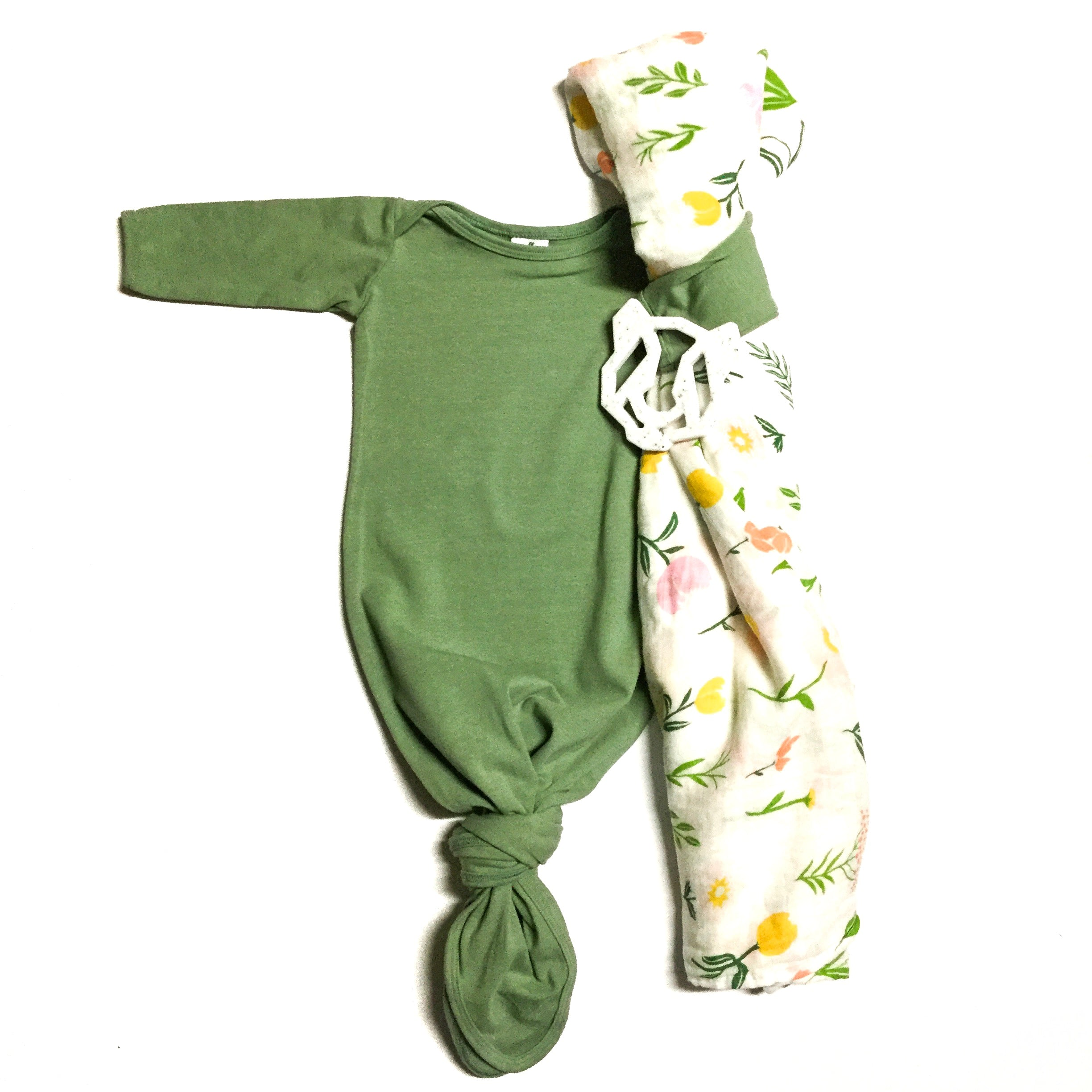 gender neutral baby gown green with spring flowers swaddle blanket and white teething toy