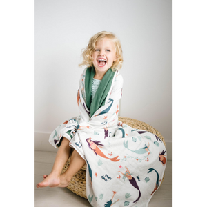 Child wrapped up in bamboo mermaid toddler blanket from little posh babes