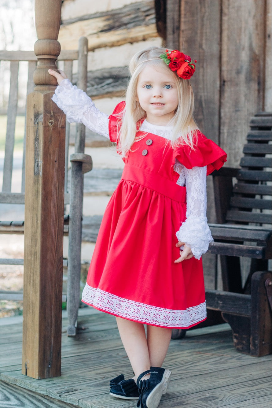 blond girl with hair bow wearing red pinafore dress unique jumper dresses for toddlers little posh babes