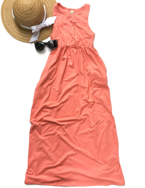 coral maxi dress with sun hat