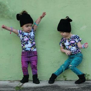 toddler girls in matching distressed legging jeans and dancing rainbow unicorn happy style for toddlers leotards
