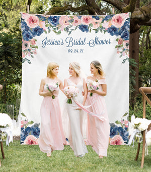 bridesmaids standing floral bridal shower photo booth backdrop