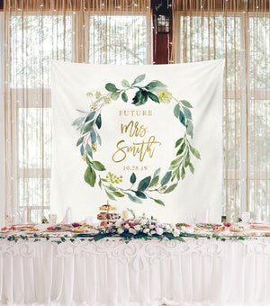 greenery bridal shower table decorations with backdrop
