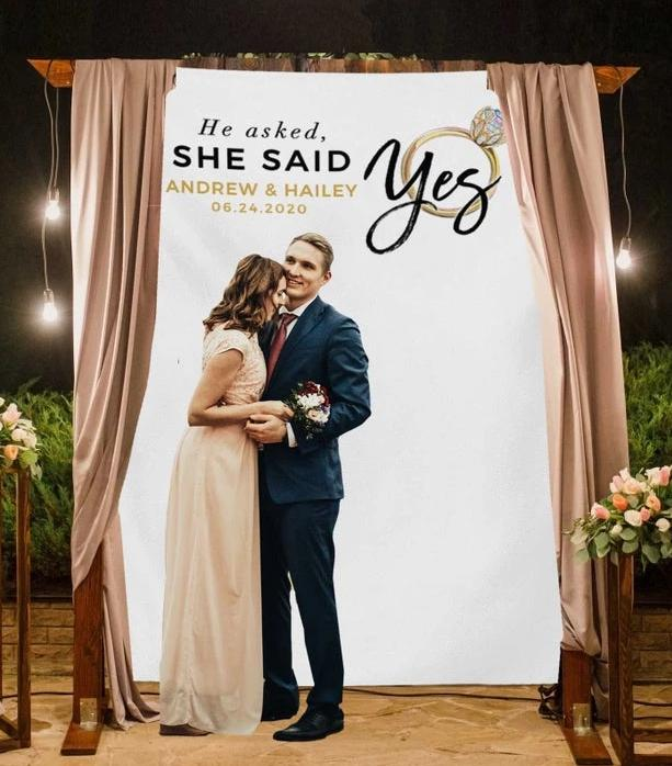 she said yes engagement part backdrop