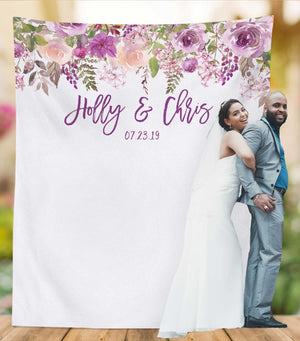 lavender wedding photo backdrop with bride and groom