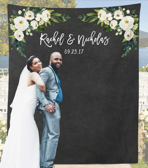 rustic wedding photo backdrop with the bride and groom
