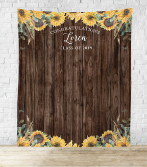 Sunflower theme graduation party photo booth backdrop hanging