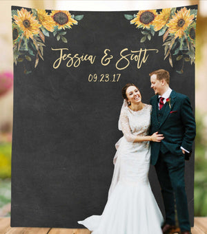 sunflower themed wedding photo backdrop with bride and groom
