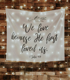 We Love Because He First Loved Us | Christian Wedding Bible Verse Backdrop Decorations - Blushing Drops