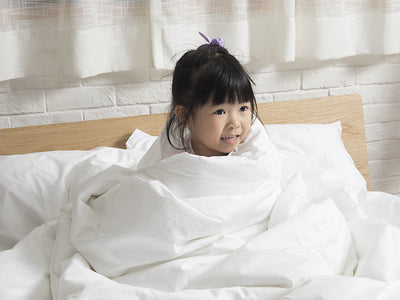 little-girl-wrap-in-duvet