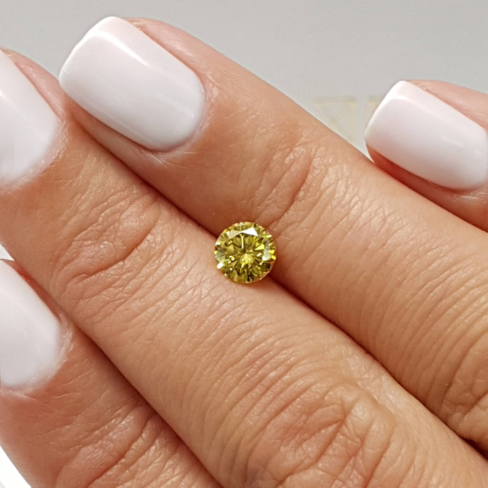 0.71 Carat Round Fancy Vivid Yellow VS1 Certified Loose Diamond