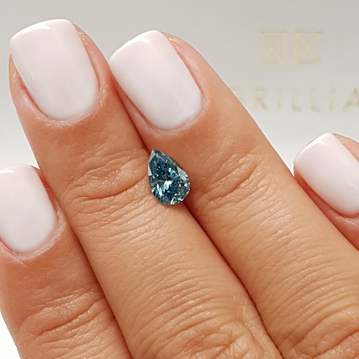 0.91 Carat Pear Fancy Deep Blue SI1 Certified Loose Diamond