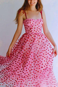 This fun and girly dress is the perfect addition to your wardrobe. The glittery heart details make you shimmer and shine while embracing the pink canvas and the ribbon tie up straps. The dresses length from waist down is 43 inches. Made of 100% polyamide tulle, pvc glitter & hearts, environmental protection glue