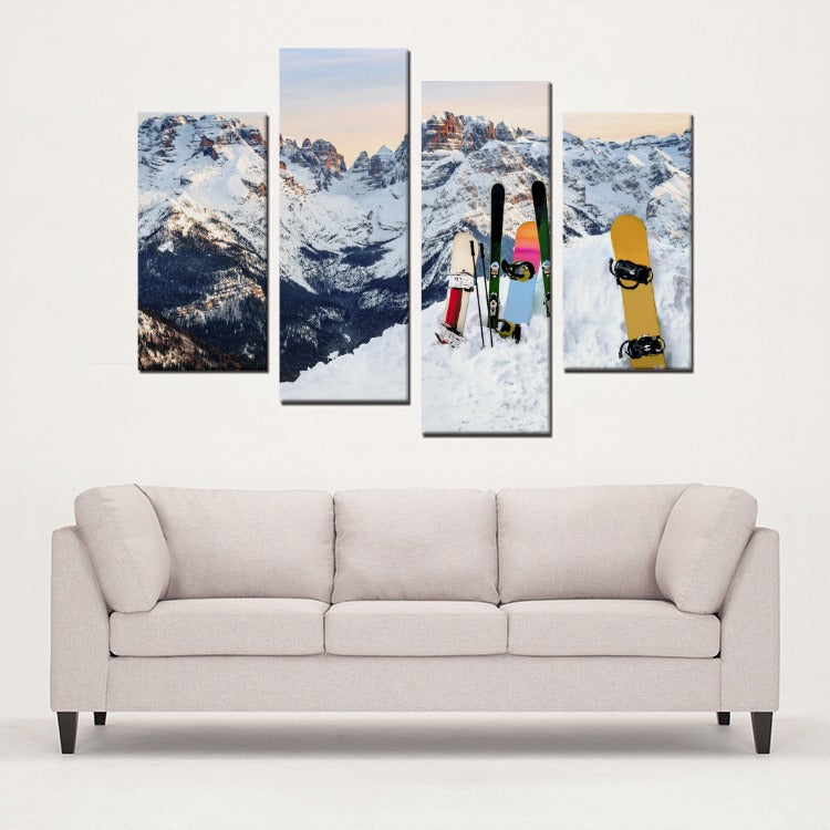 1330412ebb9 four piece framed canvas wall art of a snowy mountain with snowboards on  the hill.