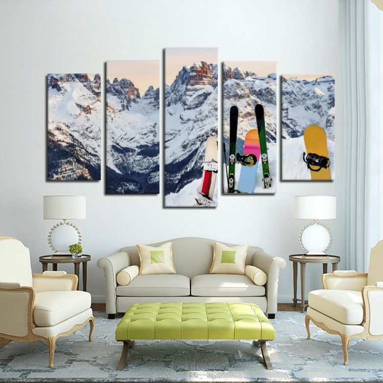 e16aa7fc0fe Five piece framed canvas wall art of a snowy mountain with snowboards on  the hill.