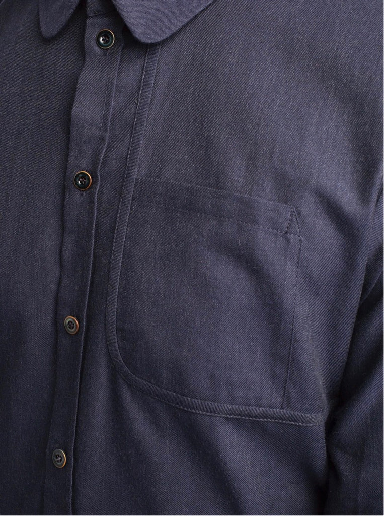 Dark blue shirt with a distinct pattern cutting element