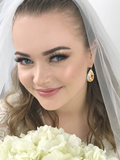 Bride wearing Pear Crystal Earrings - Yellow Iridescent Crystals