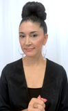 Designer, Lisa Ramos wearing crystal hoop earrings.