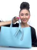Bag Designer, Lisa Ramos showcasing Blue Tote Bag Made in USA