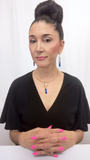 Designer, Lisa Ramos showcasing a the blue pendant.