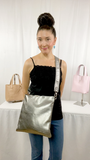 Designer, Lisa Ramos showcasing a the the MONOLISA crossbody bag