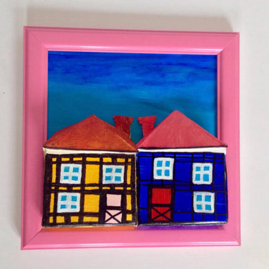 Yellow & Blue Tudor Style Houses of Copenhagen in Pink Frame with Foot