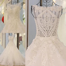 Afbeelding in Gallery-weergave laden, vintage scoop neck pearl and crystal beaded ball gowns wedding dresses 2017