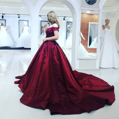 Image of maroon wedding gowns