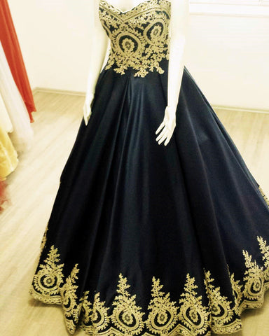 Image of quinceanera dresses black and gold