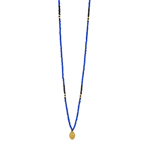 One long String Necklace feat. Azure and Black glass and Gold plated beads and a dainty Gold plated Holy Mary medal from Colombia.