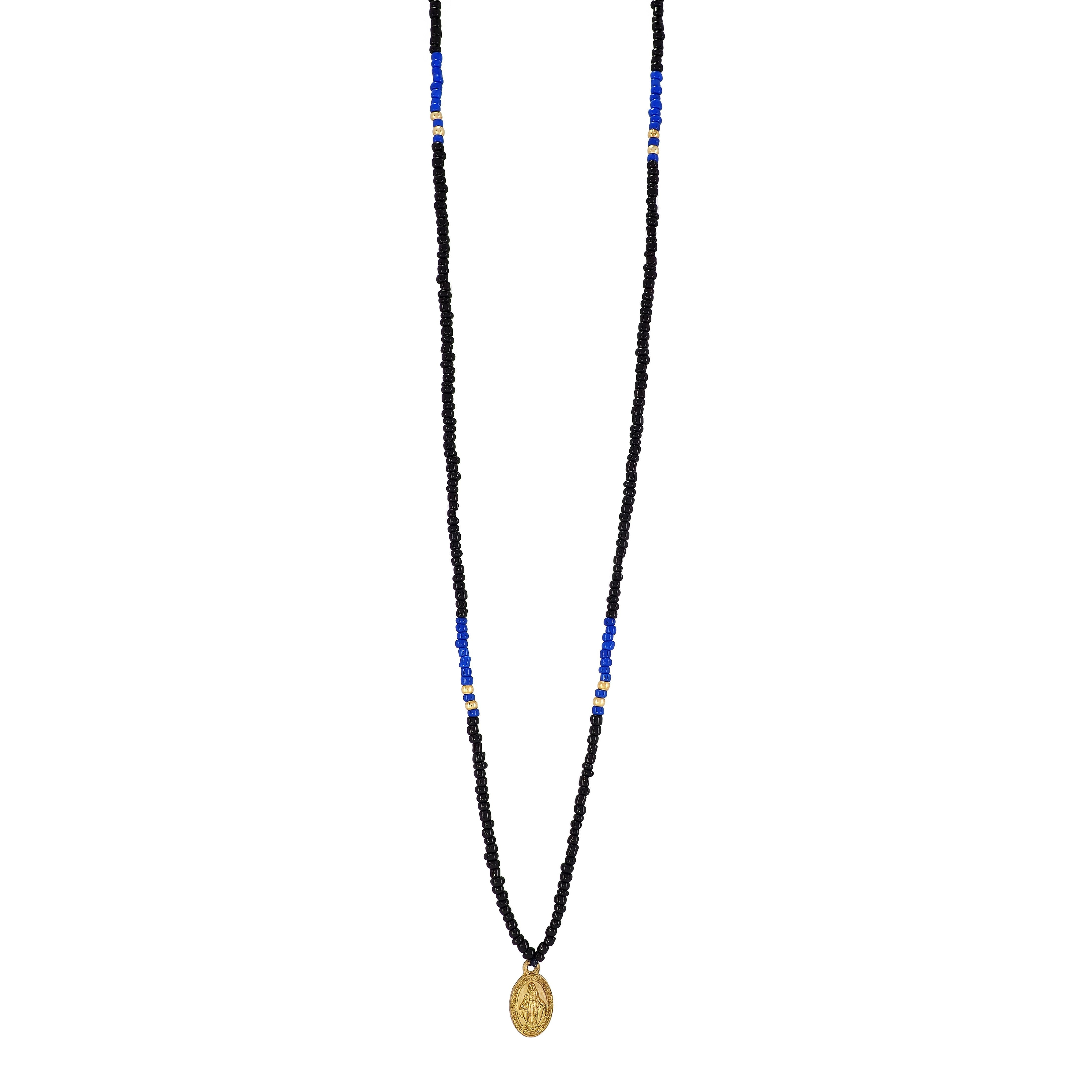 One long String Necklace feat. Black and Azure glass and Gold plated beads and a dainty Gold plated Holy Mary medal from Colombia.