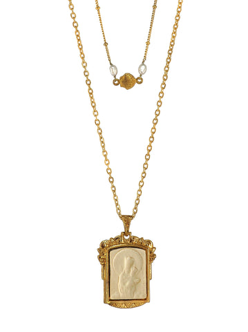 Delicate and gorgeous two layered Necklace featuring a beautiful antique San José de la Montaña pendant from Barcelona and a dainty Shell combined with two natural Freshwater Pearls set on a Rosary chain