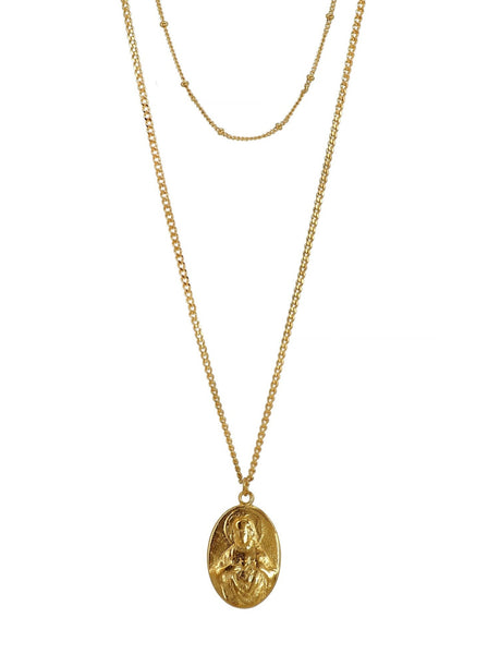 Delicate and gorgeous two layered Necklace featuring a beautiful antique Sacré-Cœur (with a Holy May and Baby Jesus relief on the reverse) pendant set on two dainty Brass chains. Everything has been recently Gold Plated in Barcelona so the beauty of the pieces is renewed to last for a very long time. A Timeless Necklace that is perfect for All Occasions. One of a Kind and Passionately crafted in Barcelona.