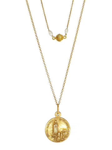 Gorgeous two layered Necklace featuring a Dazzlingly Beautiful antique pendant engraved with an image of Our Lady of Fatima from Portugal and a Sacré-Cœur relief on the reverse. A dainty Seashell combined with two natural Freshwater Pearls harmoniously rounds up the set. All the Metalwork is made of Gold Plated 925 Silver.