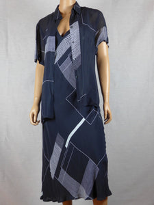 Mondi 1990 navy and white jacket and crisscrossed strapped dress.