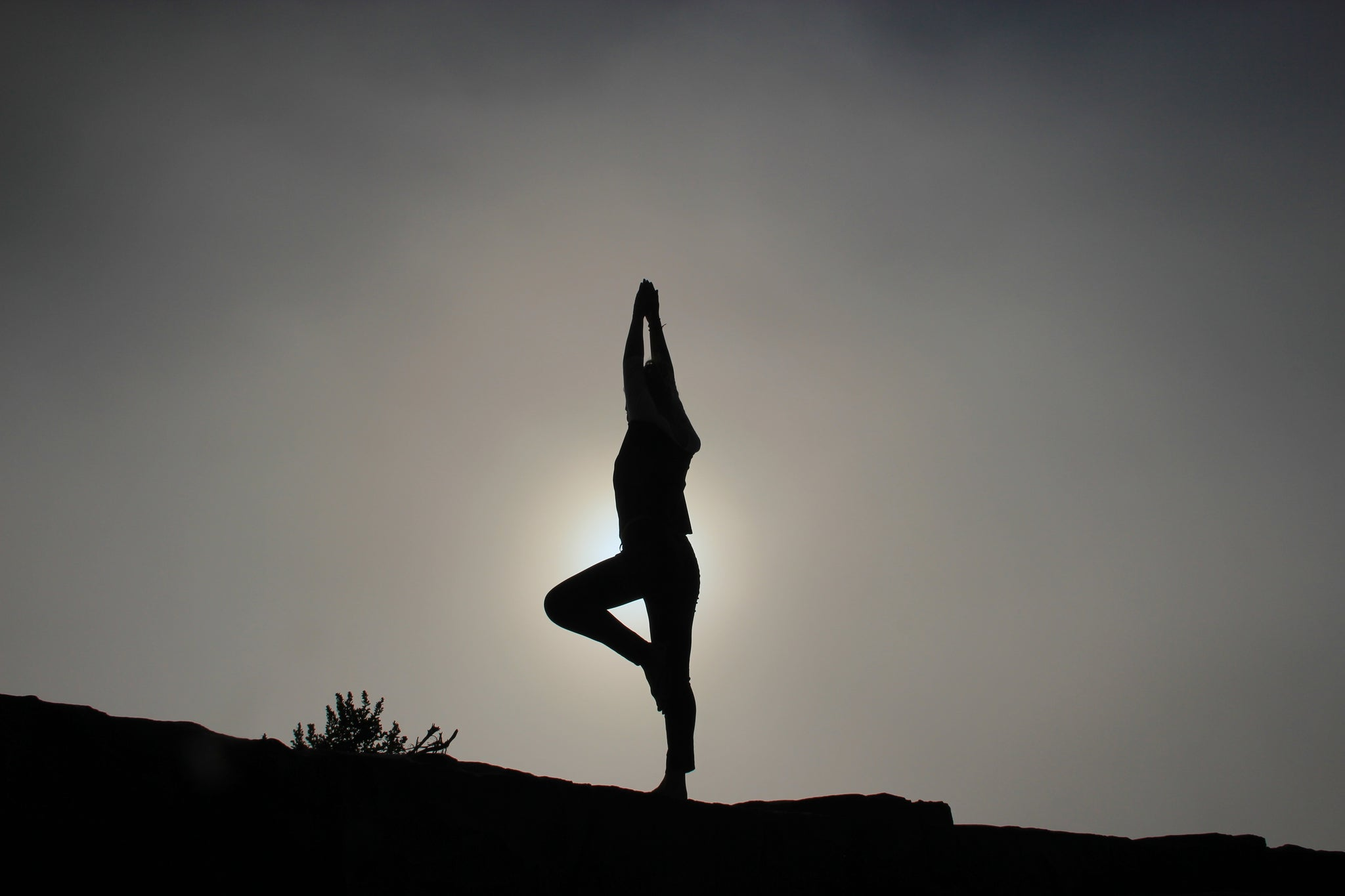 Reaching in yoga at sunset