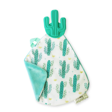 a convenient teether and cozy blanket for baby. Designed to target baby's emerging front& eye teeth as well as early molars.  The soft blanket is perfect for snuggling and absorbing drool