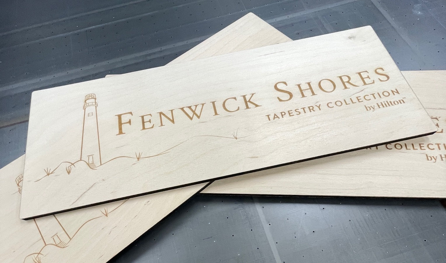 laser cut and engraved wooden signage for fenwick shores