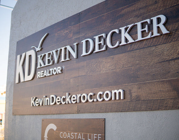 sign for kevin decker of coastal life realty group in ocean city maryland