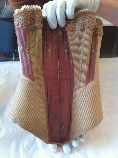 C1870-1879: MAROON AND MUSHROOM CORSET: CARROW HOUSE: COSTUME AND TEXTILE ARCHIVE (NORWICH, UK)