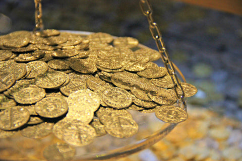 Gold coins on a Scale
